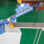 Mechanizm naciągu przewodu w maszynie BZW-PB